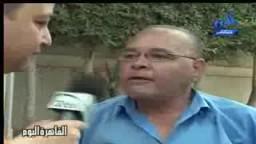 أثناء الاعتصامات - رجل يريد ان يرمي أطفاله تحت سيارة رئيس مجلس الشعب