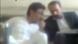 أحمد عز أثناء الحديث مع المحامى داخل سجن طرة