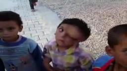 أحد الأطفال اللاجئين من سوريا في مخيم الريحانية 27-6-2011