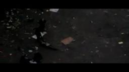 أفراد الأمن المركزى يجرون جثة أحد المتظاهرين لإلقائها بجوار القمامة
