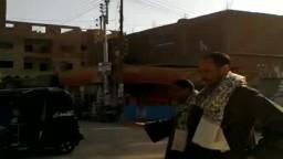 حشمت بخيت مرشح الحرية والعدالة بسوهاج يساعد في تنظيم المرور