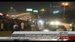 الرئيس مرسي ينزل من موكبه ليحيي المتظاهرين
