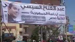 ثوار الفيوم يمزقون لافتات قائد الإنقلاب