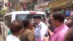 ضابط يصفع سيدة على وجهها أمام محافظ الجيزة