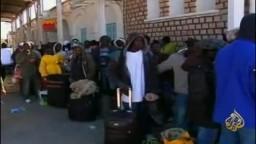 اشتباكات بين الثوار وكتائب القذافي والجنايات الدولية تحذر مسؤولين ليبين من جرائم الحرب