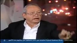 أحمد منصور يتلو آية الحجاب على ساويرس