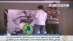 الفنان هيثم غراب يرسم الرئيس مرسي برابعة