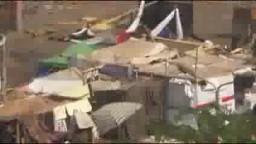 قوات الجيش والشرطة تحرق خيام النهضة